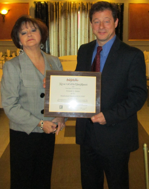 Photo courtesy Fernando Semiao Semiao accepts 2013 Realtor of the Year award from Meadowlands Board of Realtors President Nancy Lastra.