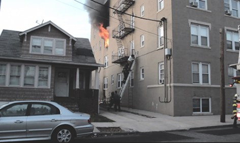 Photo Courtesy of Andy Taylor via Youtube. A resident is helped down on a ladder at a Beech St. fire Sunday afternoon. Photo Courtesy of Andy Taylor via Youtube. A resident is helped down on a ladder at a Beech St. fire Sunday afternoon.