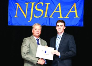 Photo courtesy NJSIAA Queen of Peace two-sport athlete Michael Pettigrew received the NJSIAA Scholar/Athlete award from NJSIAA Executive Committee President Tom Coleman at the recent NJSIAA luncheon at the Pines Manor in Edison.
