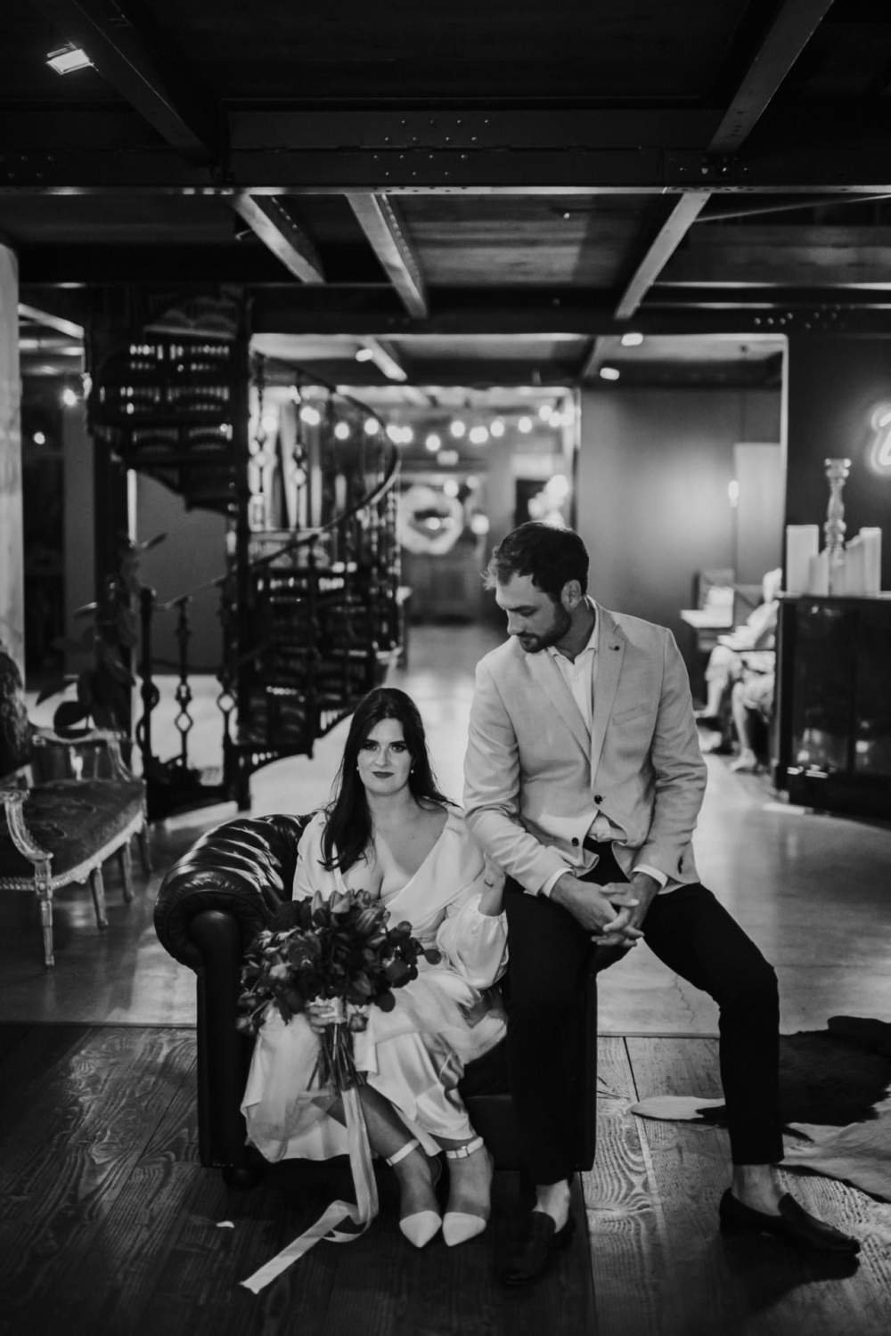 Narrows Landing Night photo of bride and groom sitting on couch