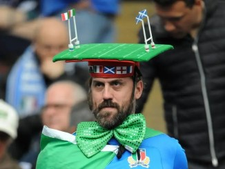 An Italian fan sports interesting head gear with a minature rugby field strapped to his head for his team's final match of this year's Six Nations campaign against Scotland at the Stadio Olimpico in Rome on 17th March