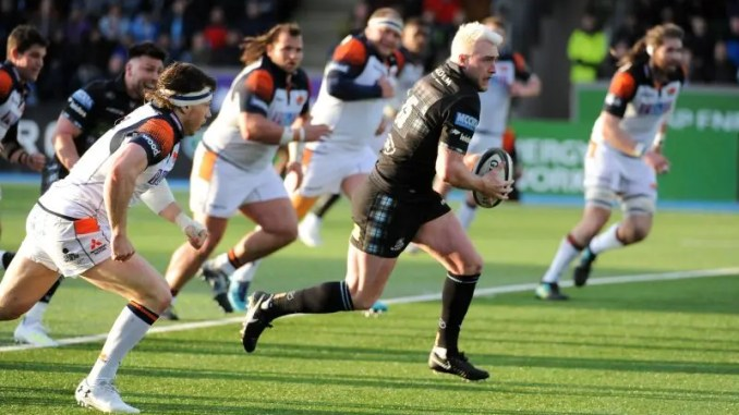 Stuart Hogg breaks through the Edinburgh defence.