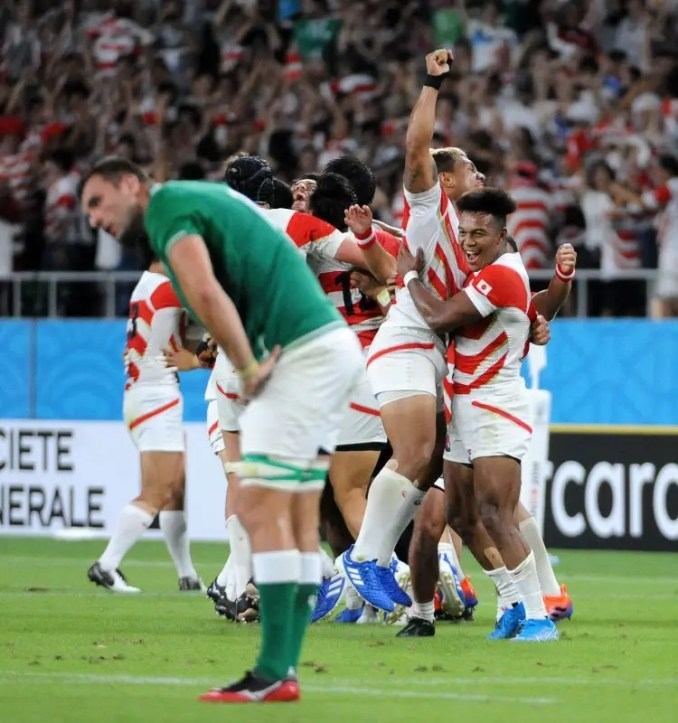 Japan players are ecstatic at the final whistle after a famous 19-12 victory over Ireland. Image: Fotosport/David Gibson