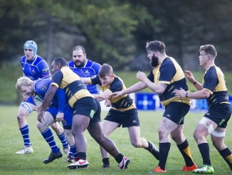 Jed's inside centre Rory Marshall under pressure from Currie's Graeme Carson. Image : Bill McBurnie