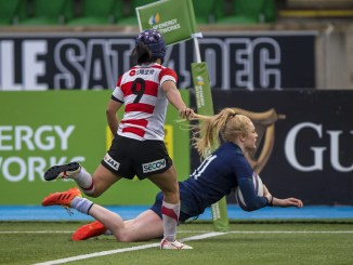 Scotland winger Megan Gaffney scores the first of her two tries against Japan.