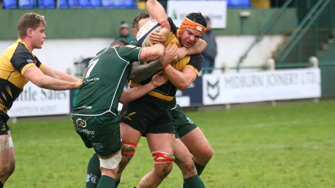Currie Chieftains No8 Rhys Davies is swallowed up by two Hawick defenders. Image: Kenny Baillie