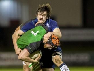 Scotland's Ewan MacDougall tackles John Foley. Image: Craig Watson ©