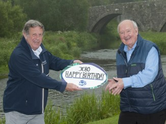 Jim Rae presents Jack Nixon with his 80th birthday card. Image: John McIntosh
