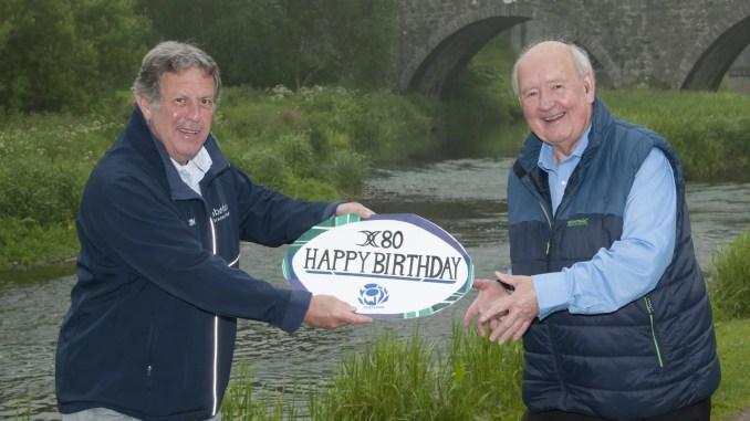 Jim Rae presents Jack Nixon with his 80th birthday card. Image: John McIntosh