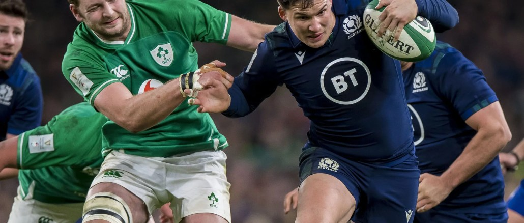 Iain Henderson of Ireland tries to get to grips with Scotland centre Sam Johnson during last year's Six Nations. Image: © Craig Watson - www.craigwatson.co.uk