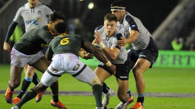 Huw Jones carries the ball for Scotland into a tackle from South African captain Siya Kolisi during last meeting between the two sides in November 2018. Image: Fotosport/David Gibson