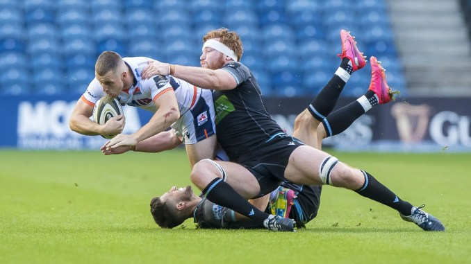 Glasgow Warriors flanker Rob Harley tackles Edinburgh centre Mark Bennett. Image: ©Craig Watson