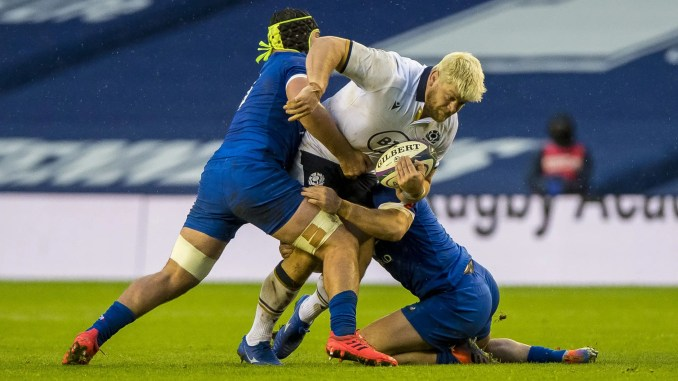 Scotland prop Oli Kebble is wrapped up by two French tacklers. Image: © Craig Watson - www.craigwatson.co.uk