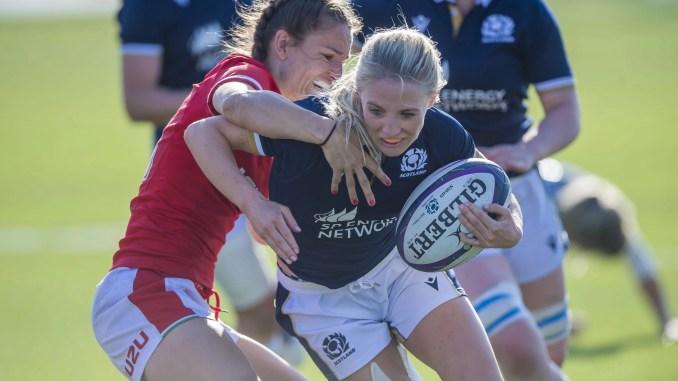Wales winger Lisa Neumann tackles Scotland scrum-half Jenny Maxwell. Image: © Craig Watson - www.craigwatson.co.uk