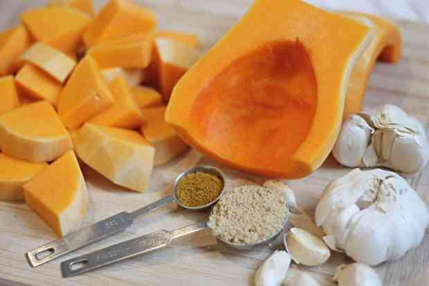 Ingredients for Butternut Squash Soup on wooden cutting board