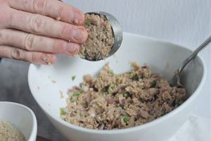 pressing tuna mixture to form a fish cake