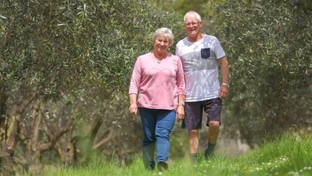 Tony and Carol O'Neill in their Olive Grove in Tasmania