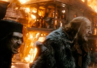 Alfrid and the Master of Lake-town in a Lake-town inferno.