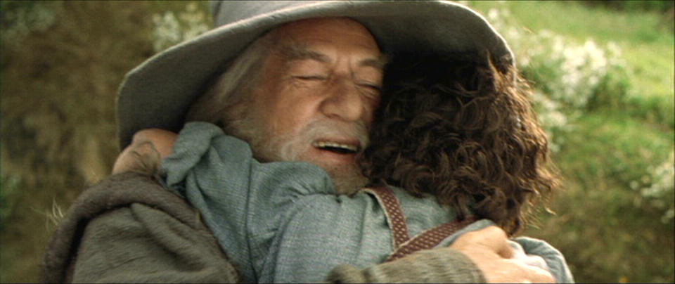 Gandalf hugging Frodo
