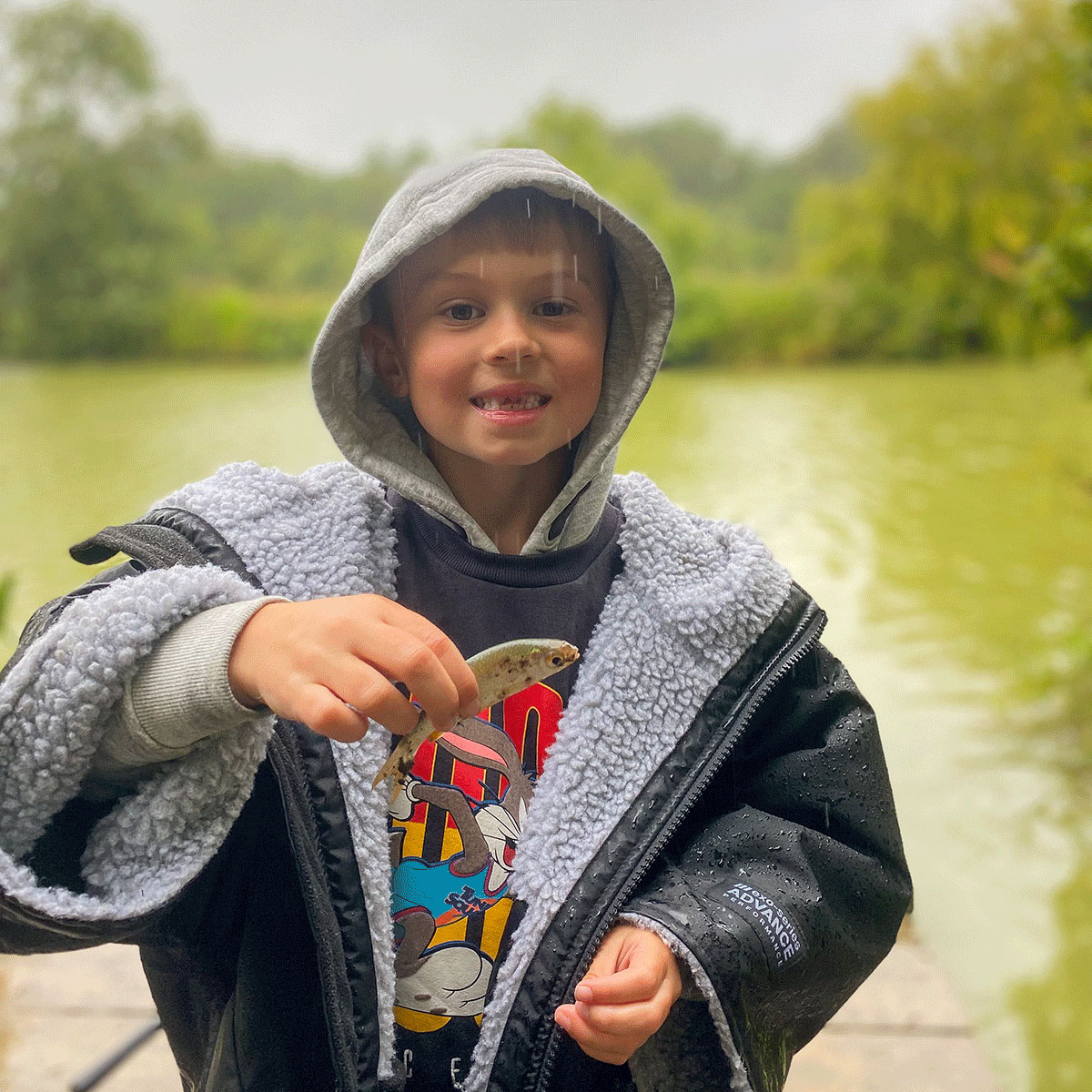 Sumners Ponds Campsite Review Staycation UK, small child catches a fish