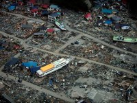 The Tohoku quake and tsunami killed at least 16,000 people. Photo credit: Wikimedia Commons. Published in East Bay Express.