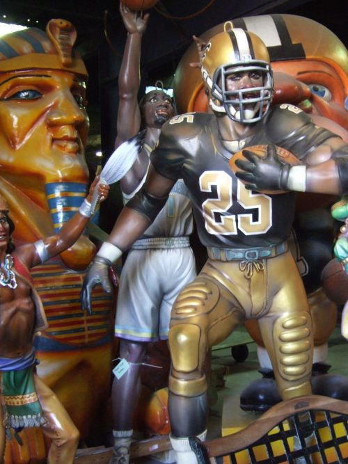 Reggie Bush Mardi Gras statue in New Orleans where maque choux is a popular dish
