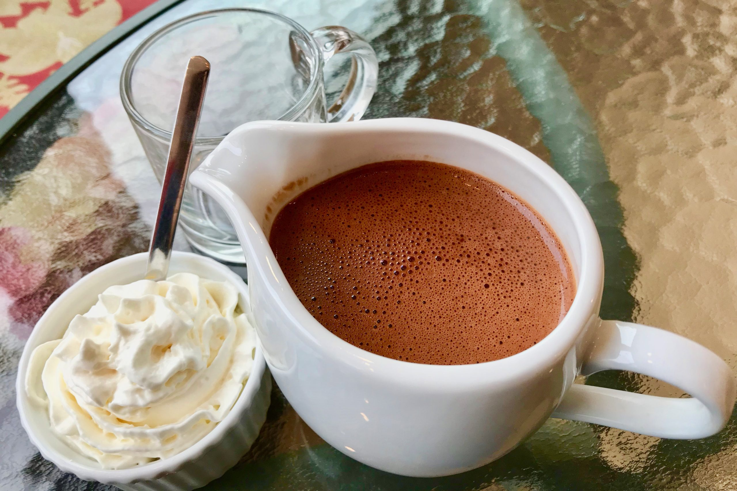 pitcher of hot chocolate and whipped cream at verdigris in the hudson valley ny