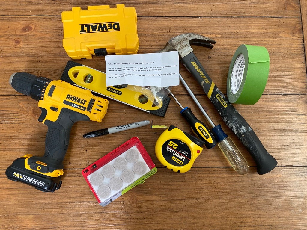 tools on a table for hanging a 1Thrive wall organizer