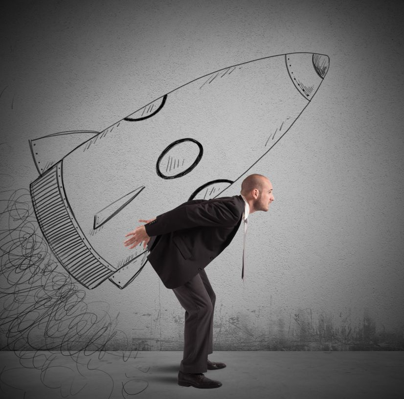 37675427 - businessman dreams to achieve success with spaceship