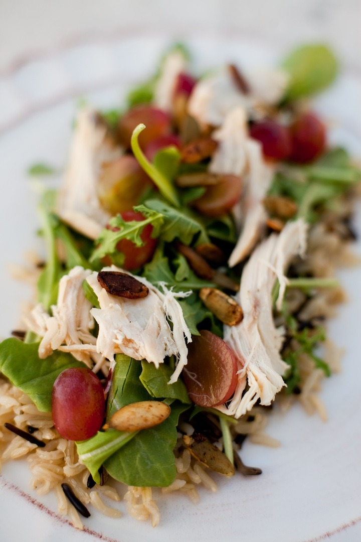 Wild Rice and Arugula Salad with Pear Chardonnay Vinaigrette on a white plate