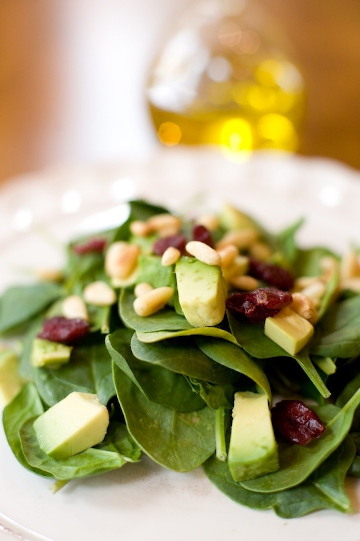spinach salad with white balsamic on a white plate