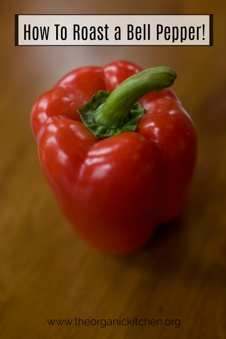 A red bell pepper sitting on a brown table: How to Roast a Red Bell Pepper