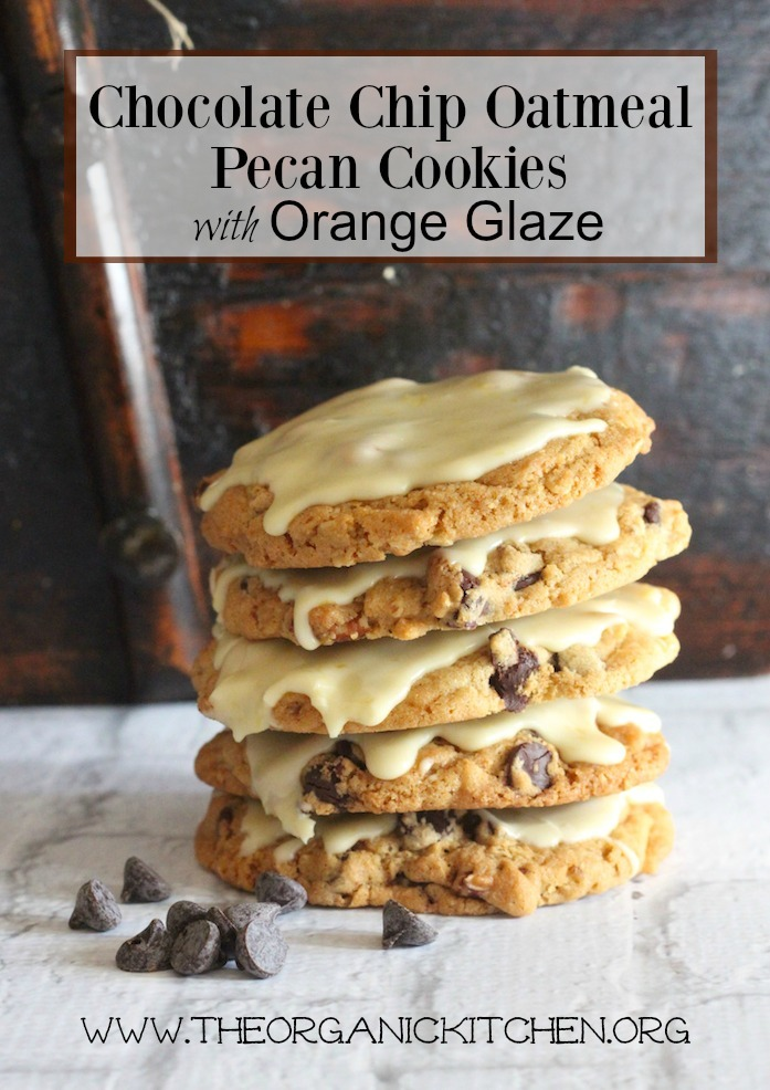A stack of Chocolate Chip Oatmeal Pecan Cookies with Orange Zest Glaze on white brick surface in in front of an aged wood wall