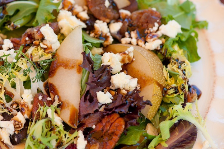 "A close up of ""Greens with Asian Pears and Fig/Maple Balsamic Vinaigrette"""