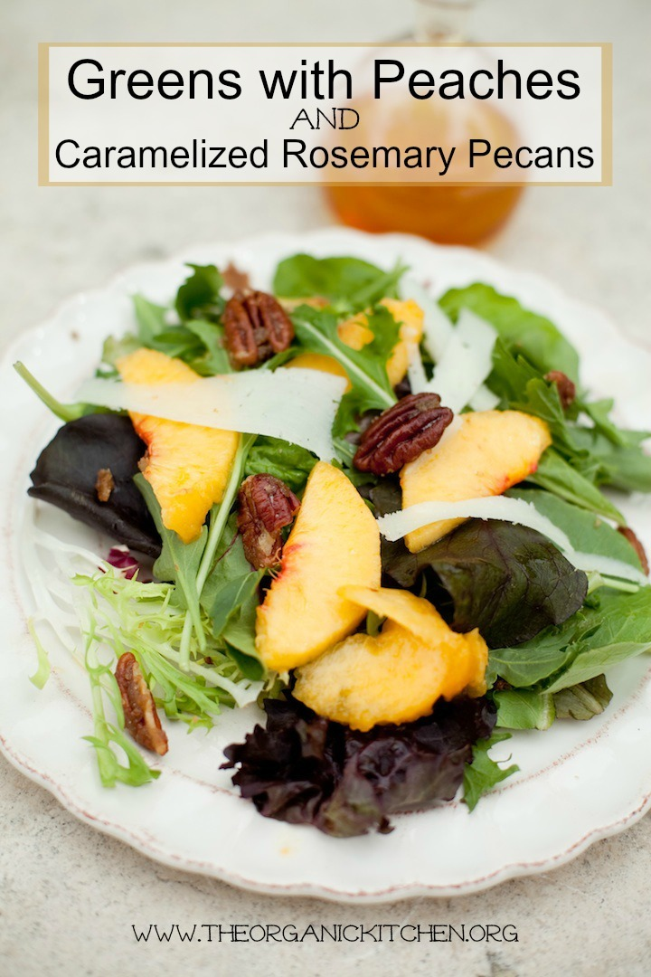 A white plate with Green Salad with Peaches, caramelized nuts, and Manchego Cheese