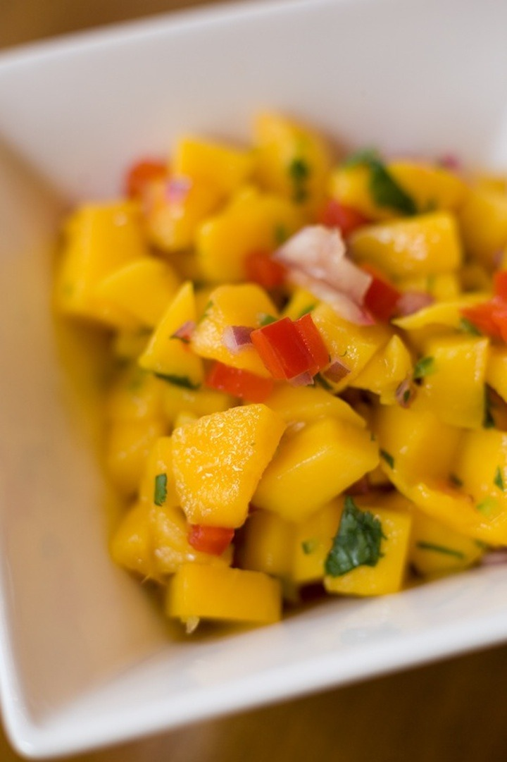 mango Salsa in a white bowl to be used on Spicy Lime Chicken