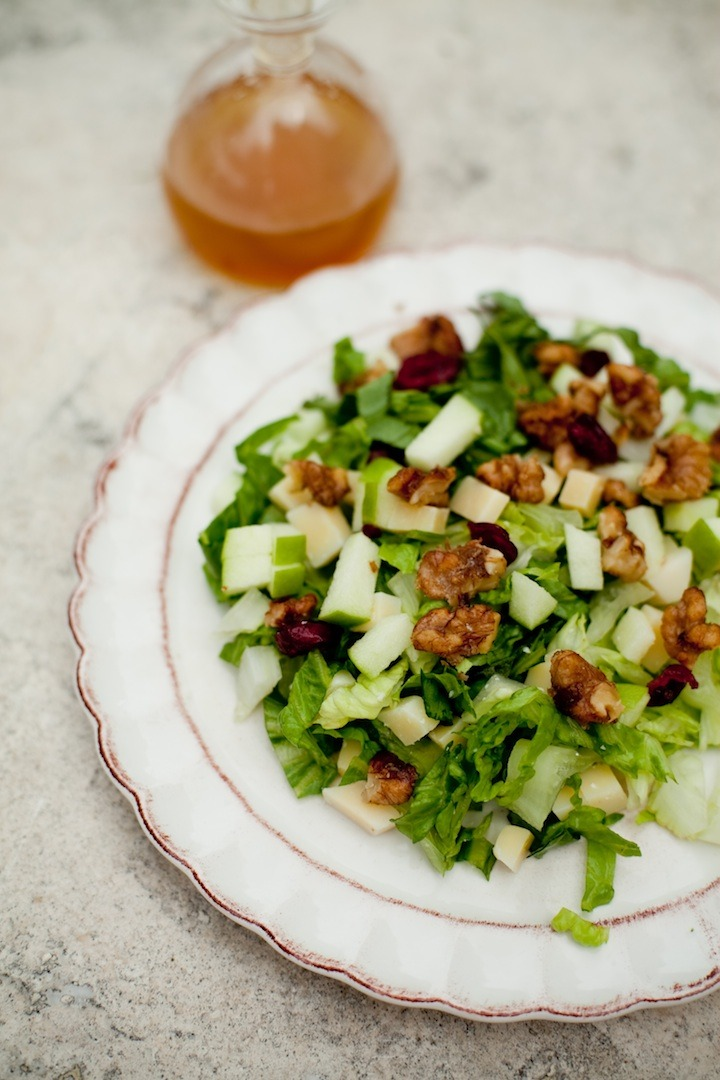 Chopped Salad with Apple Vinaigrette from The Organic Kitchen on a white plate set on a marble surface