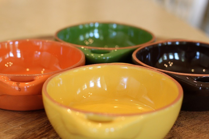 Four colorful ceramic baking dishes for Cheesy Baked Penne Rigate with a Kick!