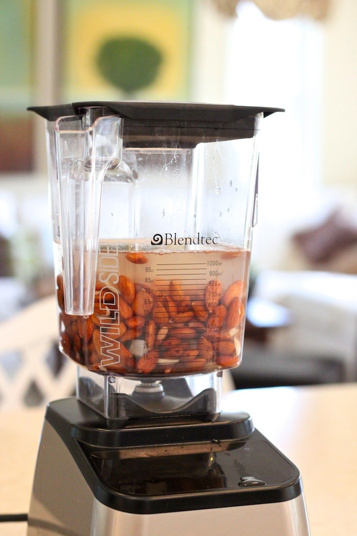 A blender with water and soaked almonds. How to Make Almond Milk