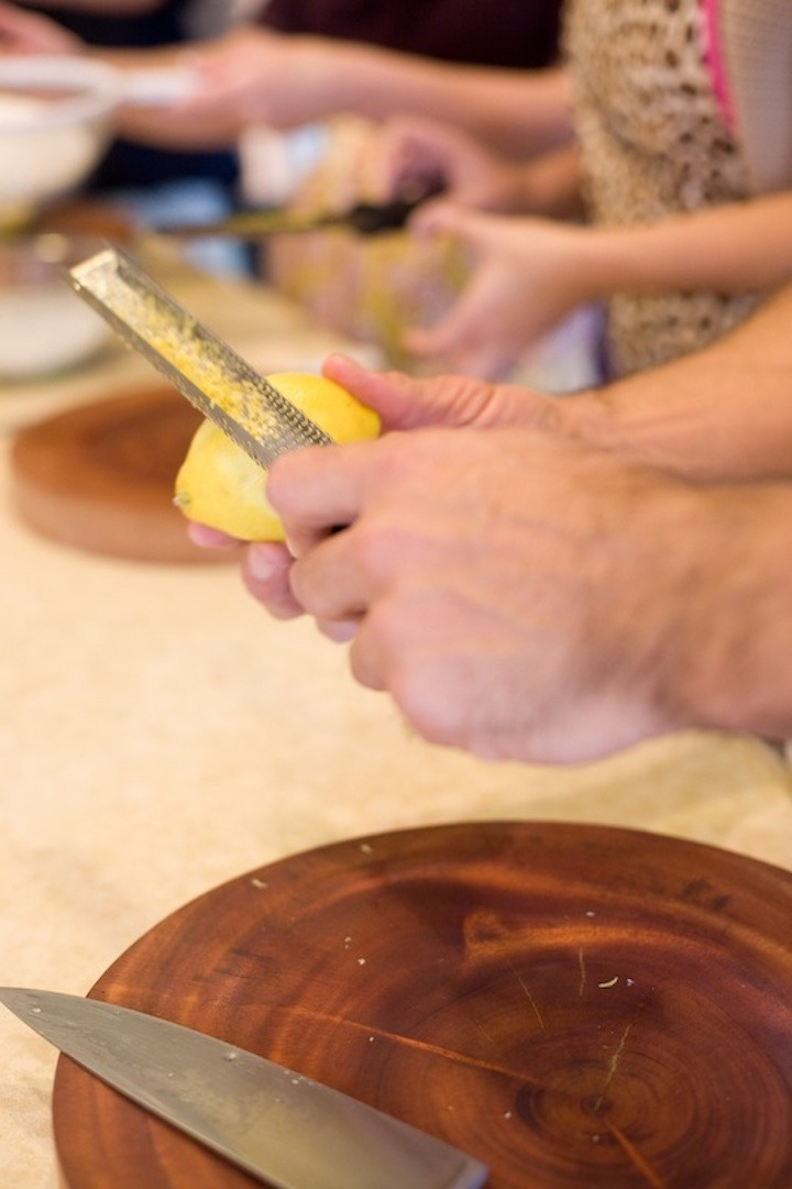 A males hands demonstrating how to zest a lemon for Lemon Shortbread Bars with Mascarpone