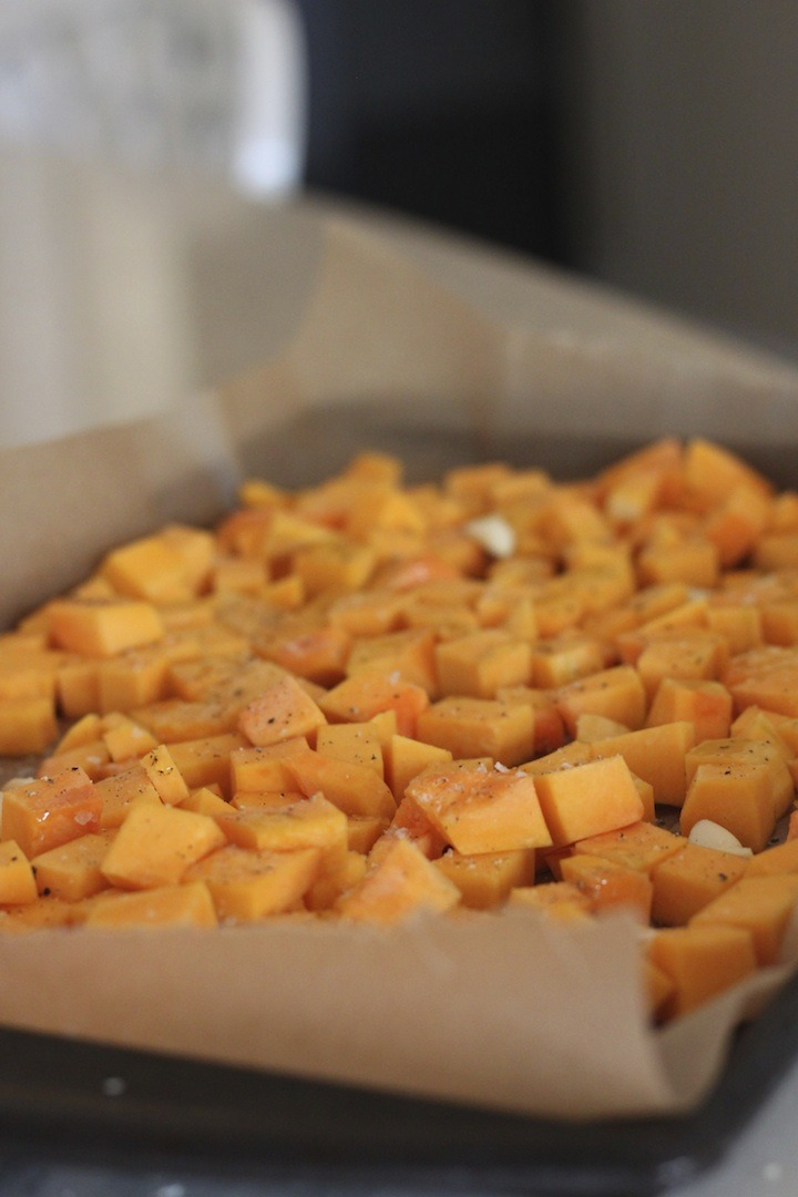 Prepared butternut squash on a rimmed cooking sheet, ready for roasting :Homemade Butternut Squash Ravioli from The Organic Kitchen