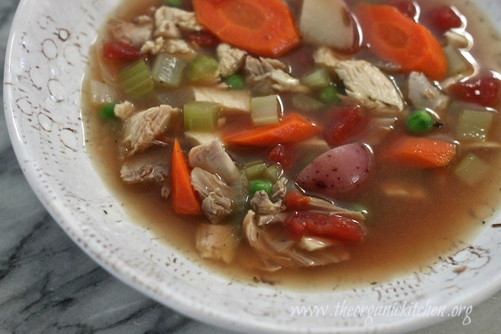 Chunky Chicken and Vegetable Soup in a white and grey bowl