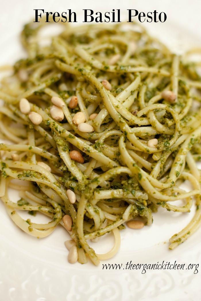 A close up of linguini with pesto on a white plate: How to Make Fresh Basil Pesto!