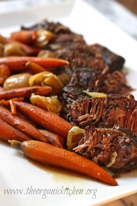 This slow cooker roast with vegetables is a family favorite Sunday dinner. It's an entire dinner in one crock pot. The meat is SO tender and delicious! This is a must-make!
