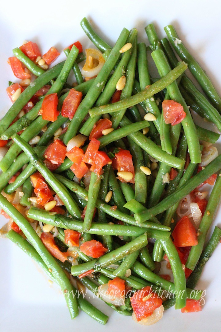 Green beans with diced tomatoes, pine nuts and chopped basil on white platter: Grandma Julia's Green beans