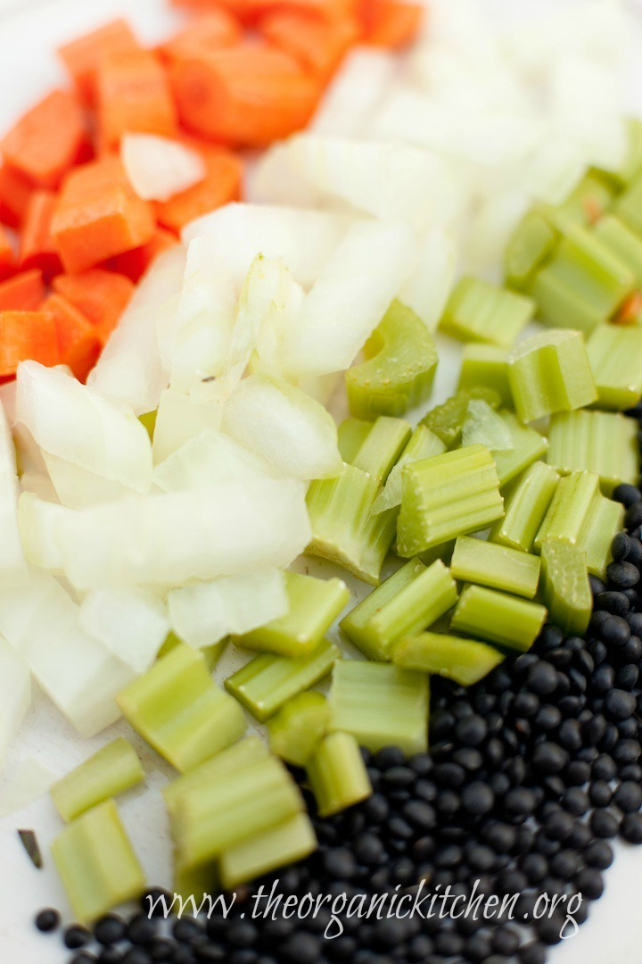 Chopped carrots, celery, onions and black lentils to be used in Hearty Lentil Soup!