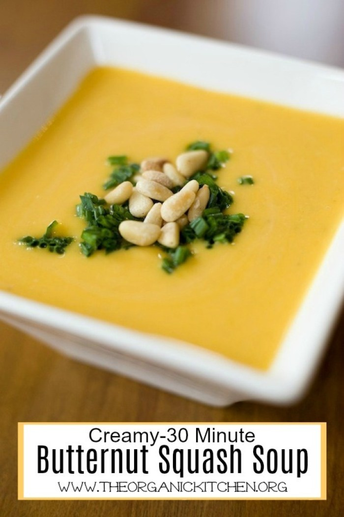 Creamy Butternut Squash Soup with a Paleo/Whole 30 option garnished with chives and pine nuts in white bowl