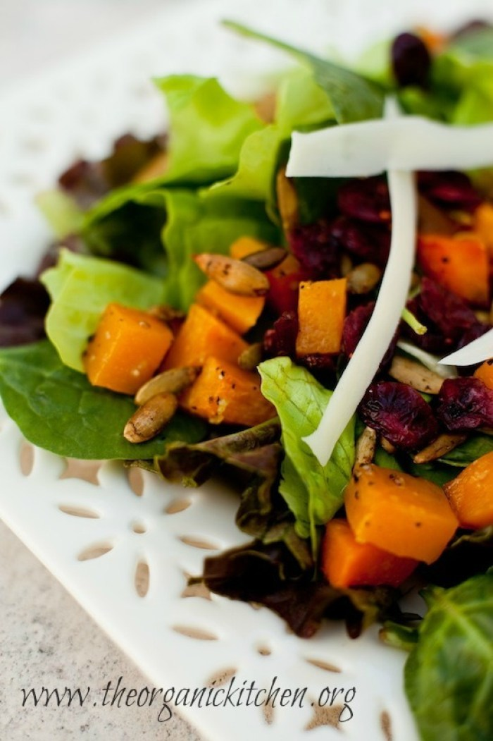 A close up Fall Greens with Roasted Butternut Squash and Spicy Pepitas
