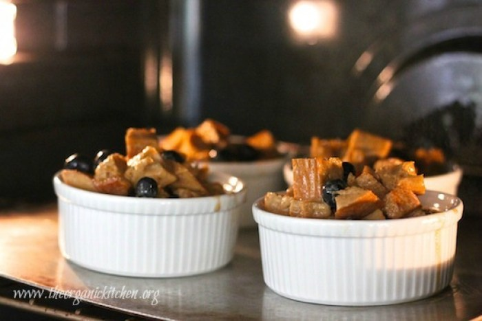 Four ramekins of Heavenly Blueberry Bread Pudding baking in the oven