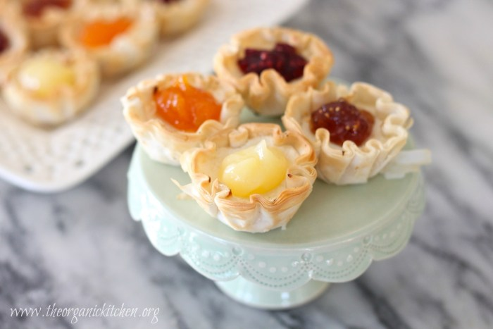 Mini Cheesecake Tartlets for All Seasons on a small cake plate